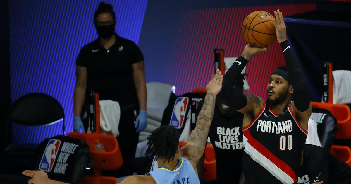 Carmelo Anthony shoots a three-pointer.